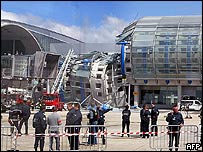 Rescuers and the wreckage of a Paris Charles de Gaulle airport building