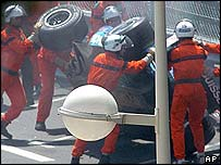 Marshalls attend to Giancarlo Fisichella's Sauber in Monaco