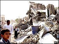 Falluja residents inspect the rubble left by a US air strike