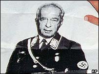 An Israeli right wing activist holds up a poster showing Prime Minister Yitzhak Rabin in a Nazi uniform, Oct. 5 1995