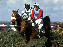 Little Polveir (right) on his way to victory in the Grand National