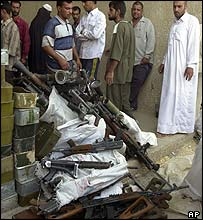 Arms being brought into a police station in Baghdad