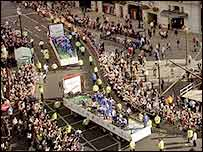 Crowds gather to watch the Olympic parade pass