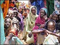 Sudanese women wait for food to be distributed in the village of Deesa, Darfur, 30 August