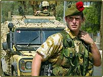 Kevin Morgan, 23, from Dunfermline, from the Perthshire-based Black Watch regiment standing in the street with during an early morning patrol in Basra city centre