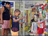 Cubans check the prices at a toy shop in Havana