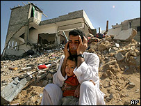 Palestinian man sits by his destroyed house in Jabaliya refugee camp, northern Gaza Strip