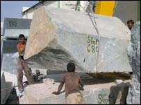 Workers and large marble block