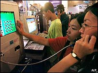 People accessing the internet through a public telephone in China