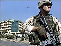 US soldier stands close to hotel near Australia's diplomatic mission in Baghdad