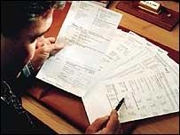 Man looking at phone bill