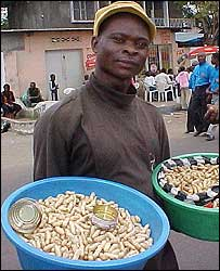 Congolese man selling peanuts in the street