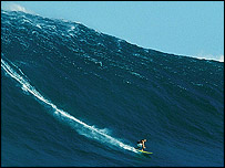 A surfer and a large wave