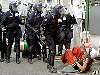 Police and a protester, Genoa, 2001