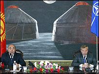 Kyrgyz President Askar Akayev, left, speaks, while NATO Secretary-General Jaap de Hoop Scheffer listens, in Byshkek, Tuesday, Oct. 19,  2004