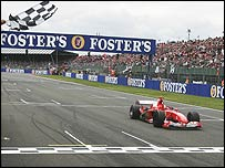 Michael Schumacher takes the chequered flag at Silverstone in 2004