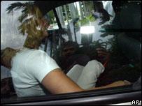 Joanne Lees (hidden under blanket) arriving at court