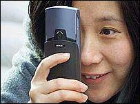 Woman using a camera phone