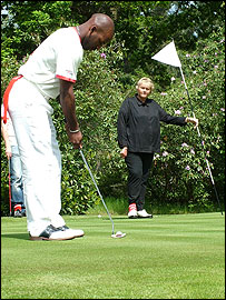 DJ Spoony lines up a putt