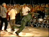 Castro falls to the floor before a rally in Havana