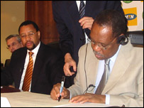 Caf president Issa Hayatou signs the sponsorship deal with MTN