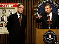 FBI chief Robert Mueller (left) and Attorney General John Ashcroft