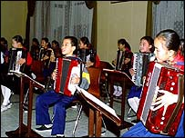Children playing instruments in North Korea