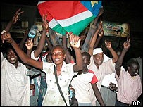 Sudanese wave the flag of the rebel Sudan People's Liberation Army