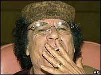 Libyan leader Muammar Gaddafi smoking a cigarette