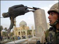 US soldiers pull down a statue of Saddam Hussein in central Baghdad