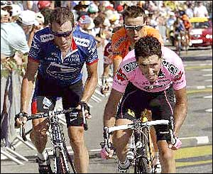 Lance Armstrong battles it out with Joseba Beloki - his leading rival during the opening week-and-a-half
