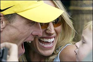 Lance Armstrong and his then wife Kristin celebrate his record-equalling fifth Tour de France win