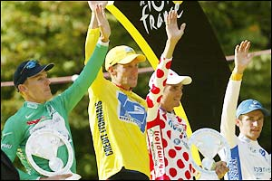 (Left to right) Green jersey winner Baden Cooke, yellow jersey wearer Lance Armstrong and King of the Mountains winner Richard Virenque on the winners' podium