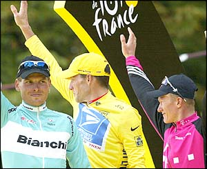 The one-two-three trio of Lance Armstrong, Jan Ullrich and Alexandre Vinokourov celebrate their heroics in Paris