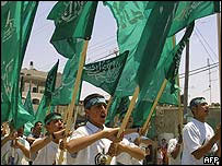 Palestinian boys wave Hamas flags in Gaza