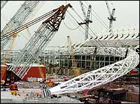 The arch begins to be lifted into place