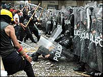 Police fall during clashes with rioters