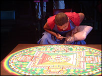 Monk preparing mandala