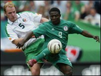 Inter Milan star Obafemi Martins holds off Gary Doherty