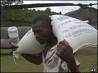 A man carries a sack of rice near Mapou