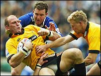 Wasps captain Lawrence Dallaglio is wrapped up by the Bath defence