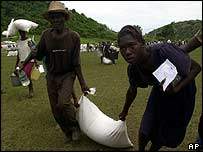 Haitian flood survivors collect food relief