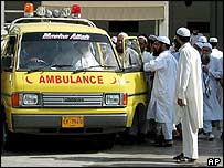 Supporters of the cleric gather around his ambulance