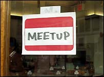 Meetup sign on the door of a cafe