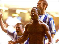 Leon Knight celebrates scoring his penalty