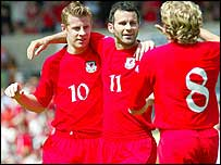 Paul Parry and Ryan Giggs celebrate Wales' winner against Canada
