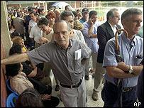 Venezuelans queue to verify their petition signatures for a vote on President Hugo Chavez 's rule