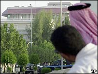 Saudis look at the scene of the hostage taking in Khobar