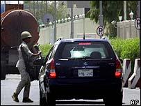 Saudi police check cars at a check point in a Khobar, Saudi Arabia