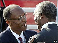 Ousted Haiti President Jean-Bertrand Aristide (l) hugs South African President Thabo Mbeki  (r)